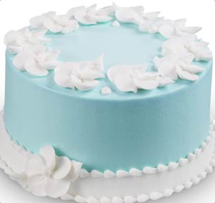 cake decorated with white petals