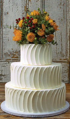 white wedding cake with 3 tiers