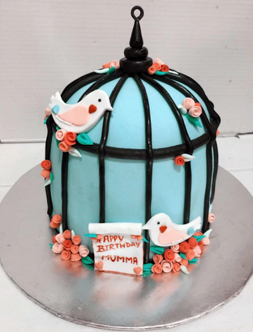 cake shaped like a bird cage
