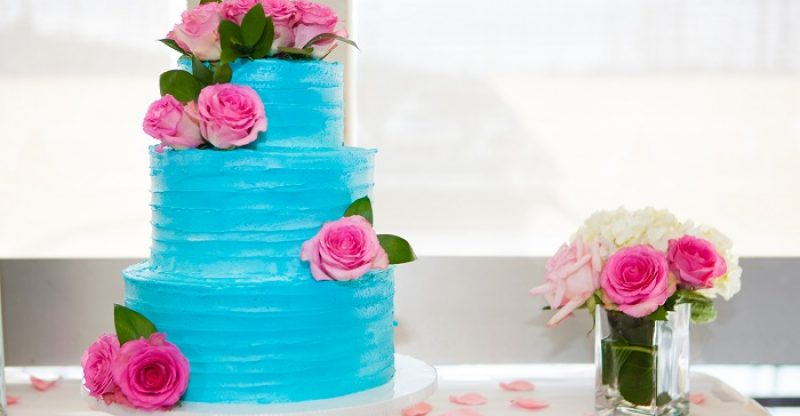 wedding cake covered in blue frosting