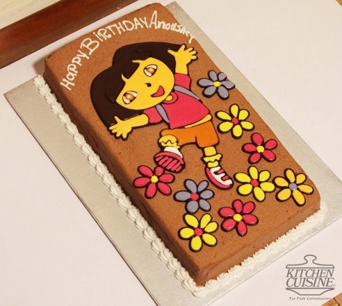 cake decorated with a Dora the Explorer drawing