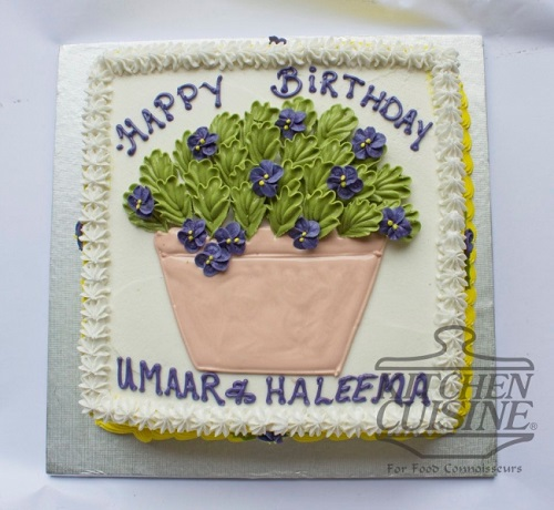 cake decorated with a flower pot