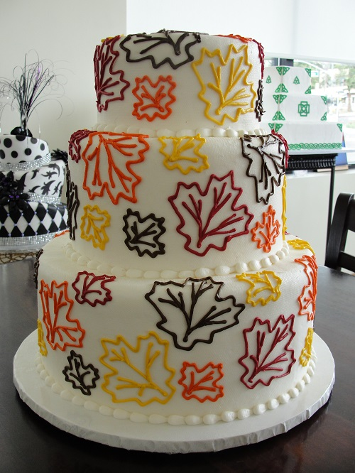 wedding cake decorated with leaves