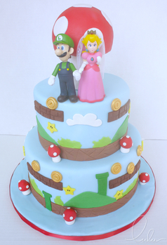 wedding cake with two mario characters on top