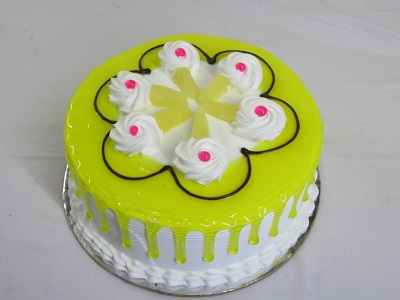 green cake decorated with cream