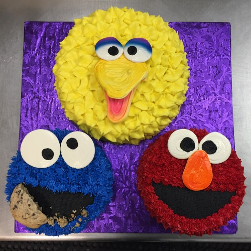 three sesame street cakes