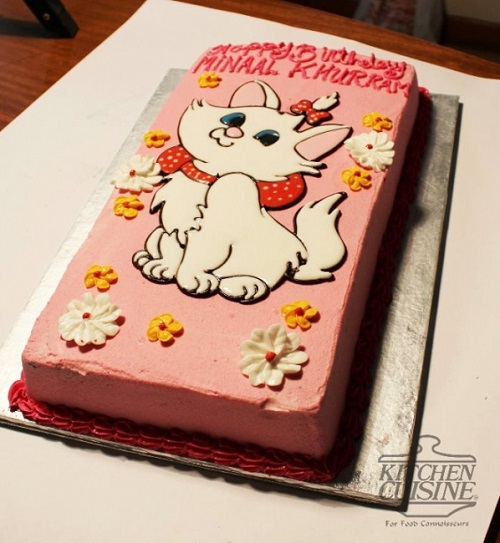 pink cake with aristocats theme