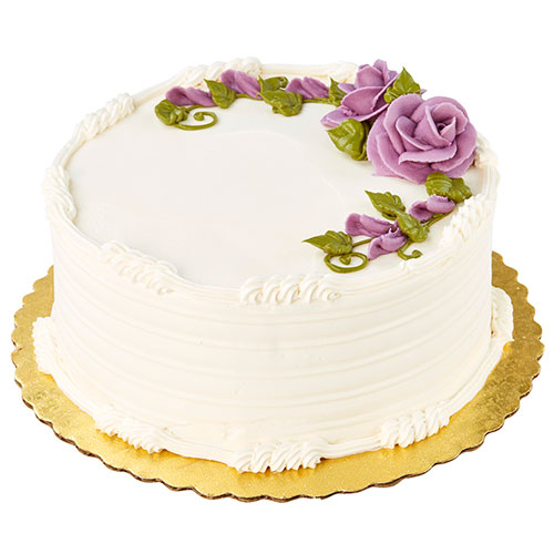 white cake decorated with roses