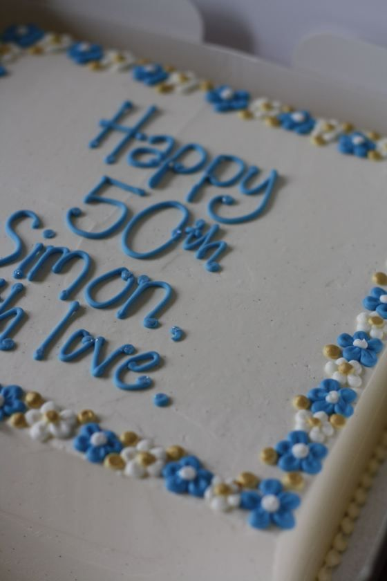 cake decorated with blue and yellow frosting