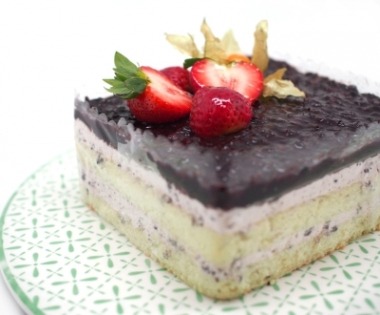 slice of cake with chocolate and strawberries